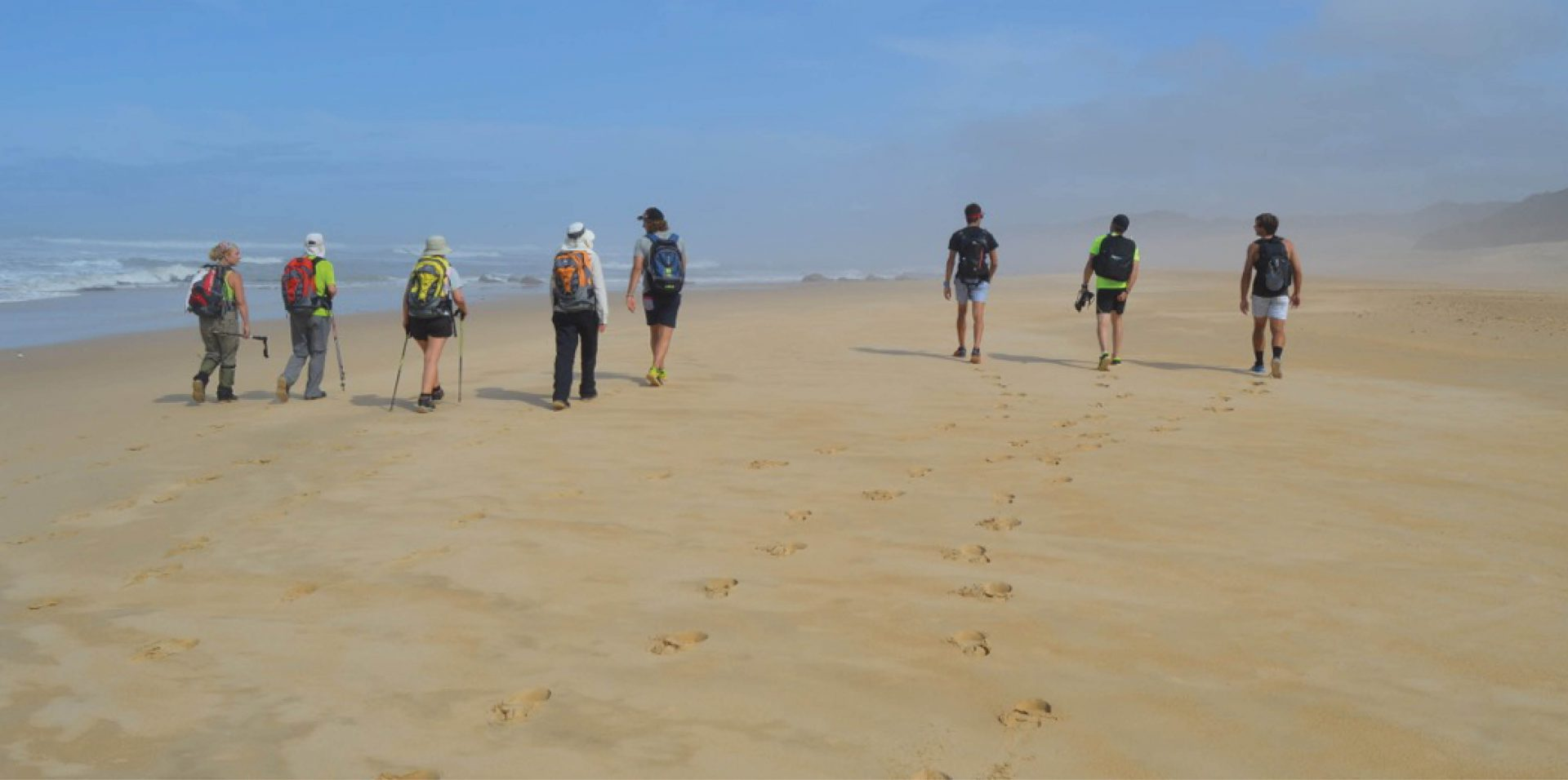 Hikers on the beach